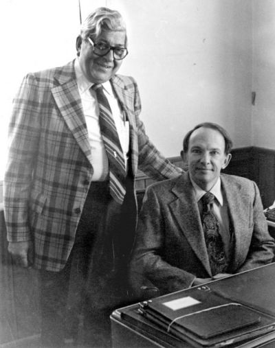 Early editor/publisher Bill Klaber (left) and Kit Cone, Jennifer's father, in 1980, when he bought the paper from Klaber after working for the newspaper for many years.